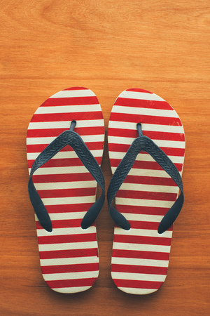 Photo for Beach sandals flip flops on wooden background with copy space for summer holiday vacation text message - Royalty Free Image