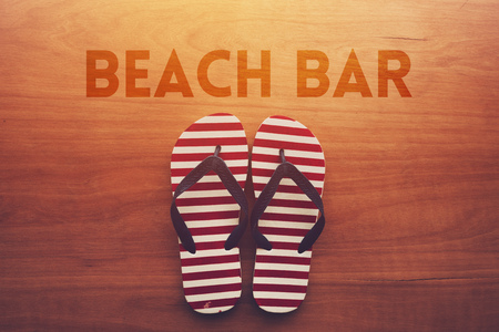 Photo for Beach bar and sandals flip flops on wooden background, summer holiday vacation concept - Royalty Free Image