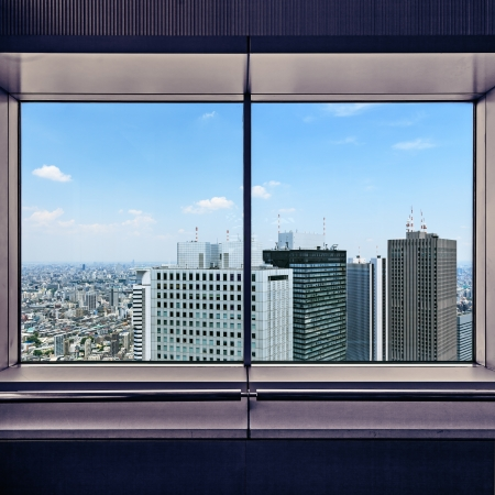 Photo pour Panoramic aerial view of Shinjuku financial district skyscrapers through a window frame  Tokyo, Japan, Asia - image libre de droit