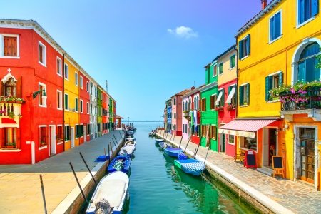 Foto de Venice landmark, Burano island canal, colorful houses and boats, Italy  Long exposure photography - Imagen libre de derechos