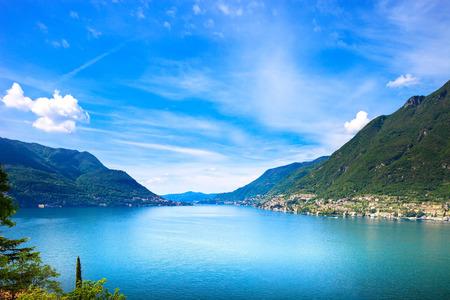 Foto de Como Lake landscape. Cernobbio village, trees, water and mountains. Italy, Europe. - Imagen libre de derechos