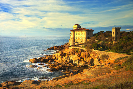 Photo pour Boccale castle landmark on cliff rock and sea on warm sunset. Tuscany, Italy, Europe. - image libre de droit