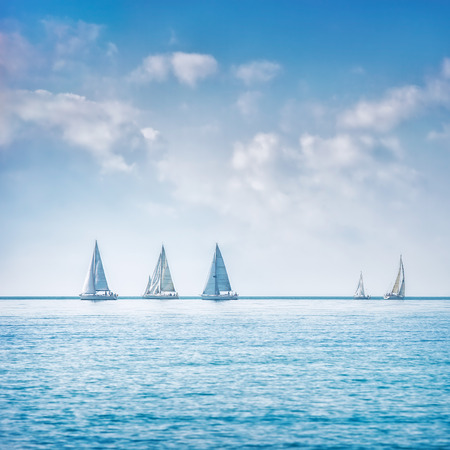 Photo pour Sailing boat yacht or sailboat group regatta race on sea or ocean water. Panoramic view. - image libre de droit