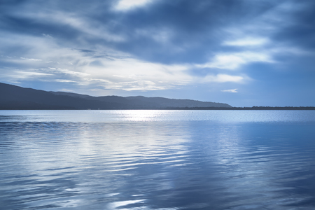 Photo pour Sunset blue landscape. Orbetello lagoon with reflection, Argentario, Tuscany, Italy. - image libre de droit