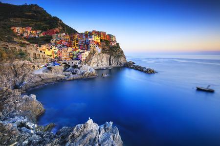 Foto de Manarola village on cliff rocks and sea at sunset., Seascape in Five lands, Cinque Terre National Park, Liguria Italy Europe. Long Exposure - Imagen libre de derechos