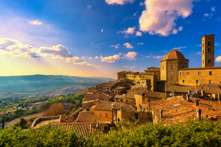 Photo for Tuscany, Volterra town skyline, church and panorama view on sunset. Maremma, Italy, Europe - Royalty Free Image