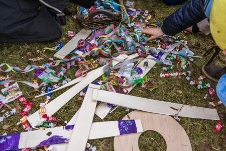 Foto de Hit the cat out of the barrel and the candy comes out. A danish custom in Shrovetide. Frederikssund, Denmark - February 11, 2018 - Imagen libre de derechos