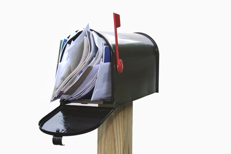 Foto de Mail box overflowing with mail, bills, junk mail, e-mails and other unwanted correspondence - Imagen libre de derechos