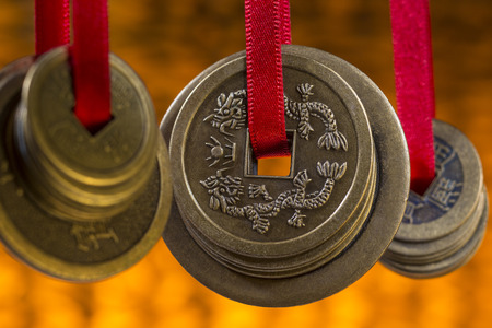 Photo for Antique Chinese coins in a hotel in Beijing in China. - Royalty Free Image