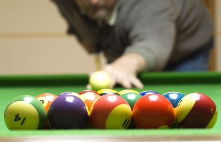 A man shooting a game of pool