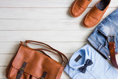 Foto de Flat lay, Men's fashion casual outfits and accessories on white wooden background - Imagen libre de derechos