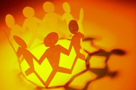 Photo pour Group of people holding hands in a circle - image libre de droit