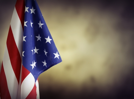 Photo pour American flag in front of plain background. Advertising space - image libre de droit