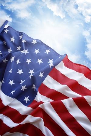 Photo pour American flag in front of blue sky - image libre de droit