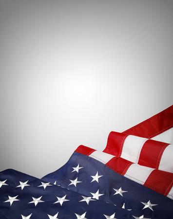 Foto de Closeup of American flag on grey background - Imagen libre de derechos