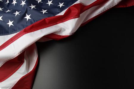 Foto de Closeup of American flag on dark background - Imagen libre de derechos