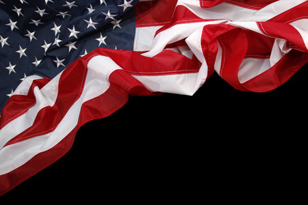 Photo pour Closeup of American flag on dark background - image libre de droit