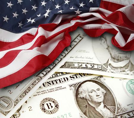 Photo pour American flag and banknotes - image libre de droit