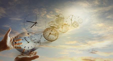 Photo pour Hands and clocks in sky - image libre de droit