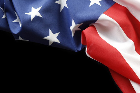 Foto de Closeup of American flag on black background - Imagen libre de derechos