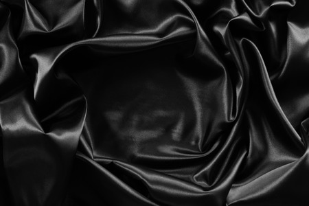 Photo pour Closeup of rippled black silk fabric - image libre de droit