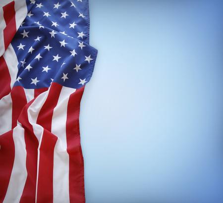 Foto de American flag on blue background - Imagen libre de derechos