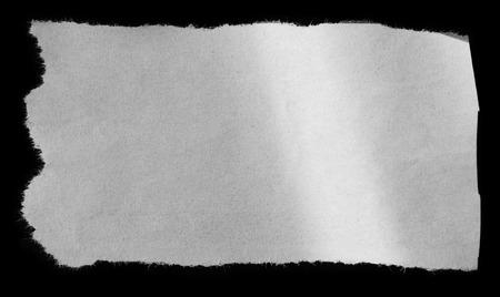 Foto de Piece of torn paper on black - Imagen libre de derechos
