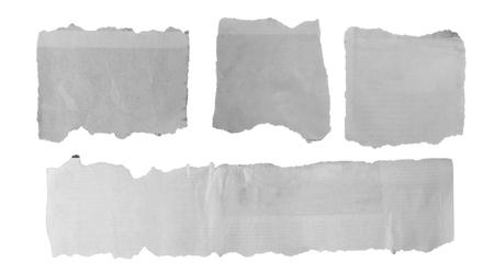 Foto de Four pieces of torn paper on plain background - Imagen libre de derechos
