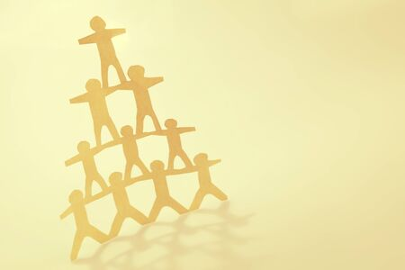 Photo for Human team pyramid supporting each other - Royalty Free Image