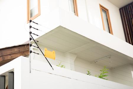 Photo pour Electric fence for protect residential house - image libre de droit