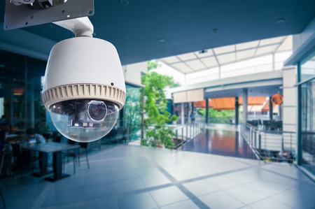Foto de CCTV Camera Operating inside a station or department store - Imagen libre de derechos