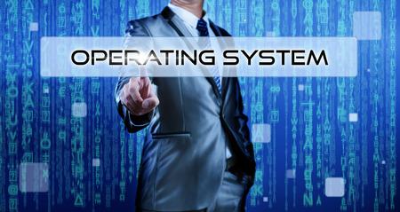 Foto de Business man with digital background pressing on button operating system - Imagen libre de derechos