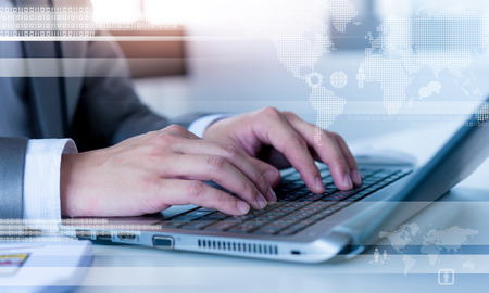 Foto de Close up of business man typing on laptop conputer with technology layer effect - Imagen libre de derechos