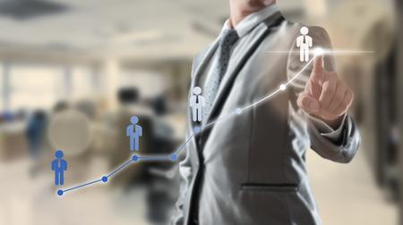 Photo pour Businessman working with digital visual object, human resource concept - image libre de droit