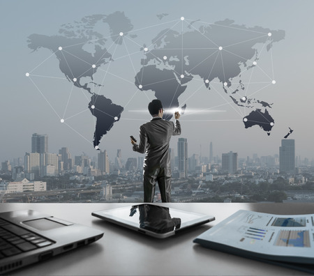 Foto de Businessman pressing on digital virtual screen, globalization marketing conceptual - Imagen libre de derechos
