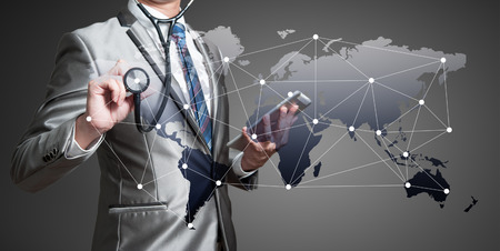 Foto de Business man with stethoscope, globalization business concept - Imagen libre de derechos