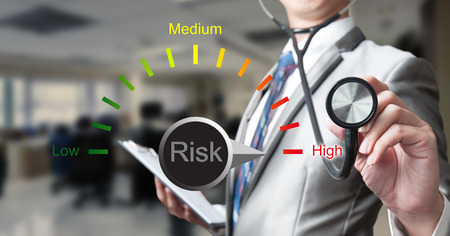Foto de Business man with stethoscope with risk management concept - Imagen libre de derechos