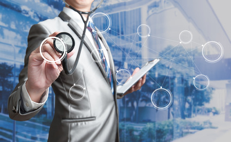 Photo pour Business man with stethoscope, business concept - image libre de droit