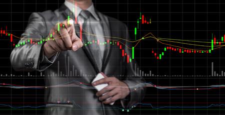 Foto de double exposure of businessman with stock market chart - Imagen libre de derechos