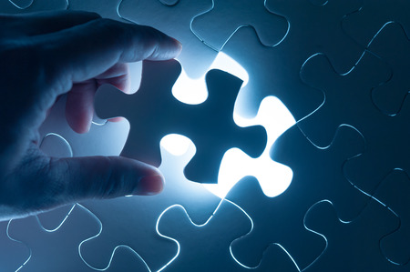 Photo pour Hand holding jigsaw - conceptual image of business strategy - image libre de droit