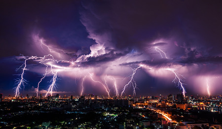 Photo for Lightning storm over city in purple light - Royalty Free Image