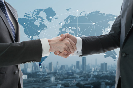 Photo for business hand shake with digital graph in background - Royalty Free Image