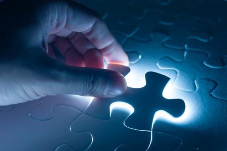 Photo pour Hand insert jigsaw, conceptual image of business strategy - image libre de droit