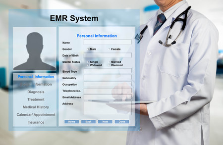 Foto per Doctor working with EMR - Electronic Medical Record system - Immagine Royalty Free