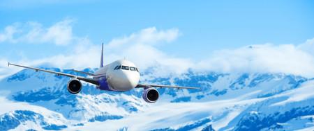 Foto de Airplane with background of snow mountain, exploration conceptual - Imagen libre de derechos