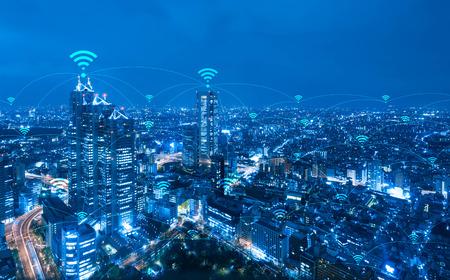 Foto de Cityscape with wifi connection conceptual,information communication technology concept - Imagen libre de derechos