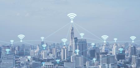 Foto de Blue high-tech tone of cityscape conneted line with wifi sign, technology concept, internet of things conceptual - Imagen libre de derechos