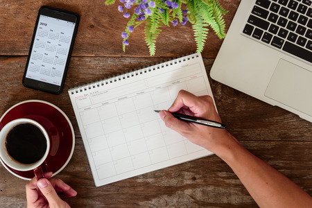 Photo pour SEPTEMBER 17, 2018: Working table top with organizer for monthly planing with Iphone 8 plus use calendar application with year 2019 - image libre de droit