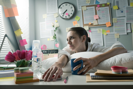 Photo for Overworked office woman with pillow working at computer. - Royalty Free Image