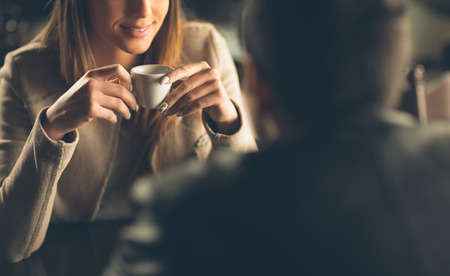 Photo pour Young fashionable couple dating at the bar, she is having a coffee - image libre de droit